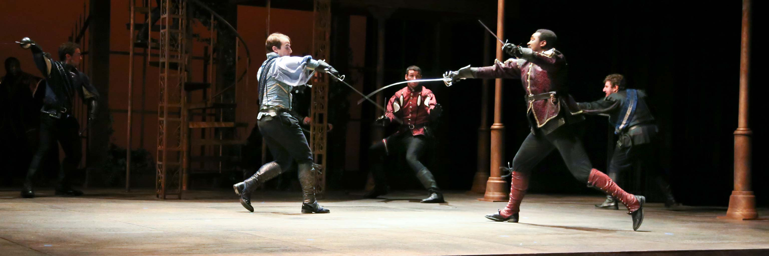 sword fighting during a performance