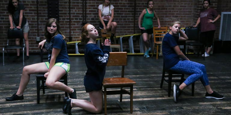 three women rehearse scene